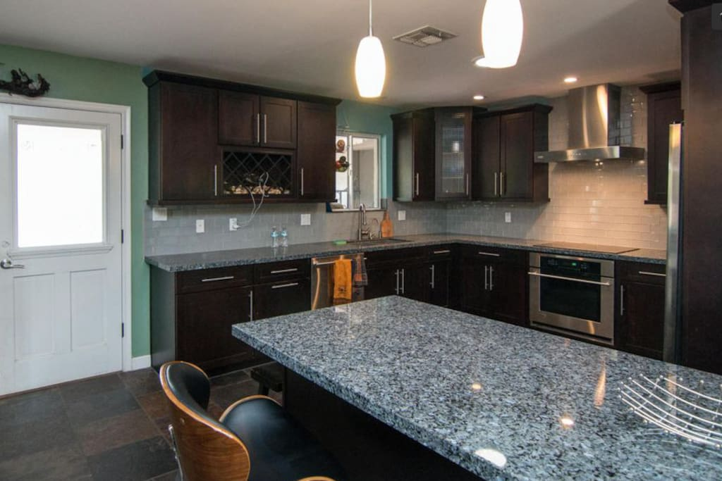 Updated kitchen with granite counters and stainless steel appliances, coffee maker and appliances will be available