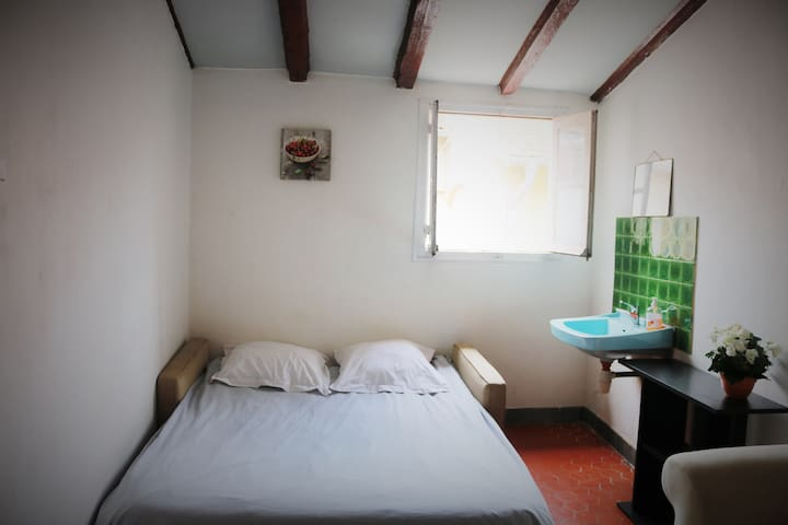 Sunny room with double bed and sink