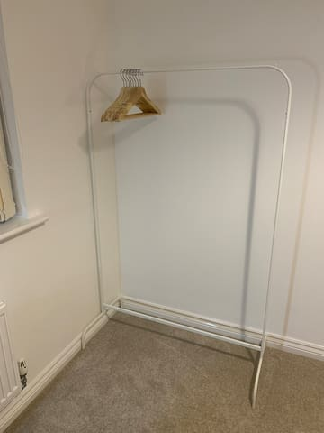 Private double bedroom - clothes rack and hangers