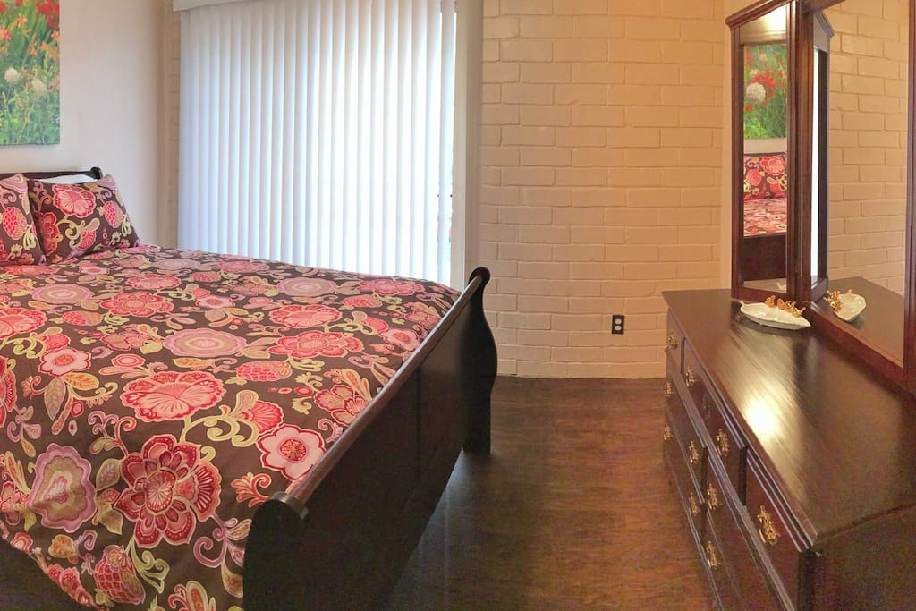 Queen bed in bedroom and deluxe queen air mattress also provided.