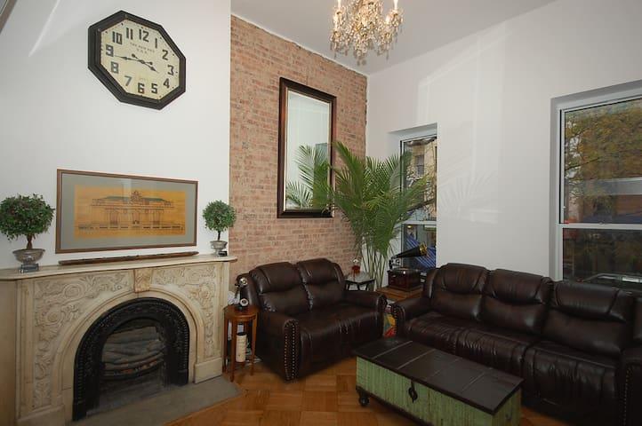 LUXURY Brownstone, 13 ft ceilings, exposed brick
