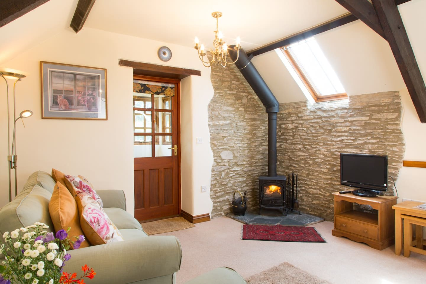 The warm sunny living room, with woodburner.