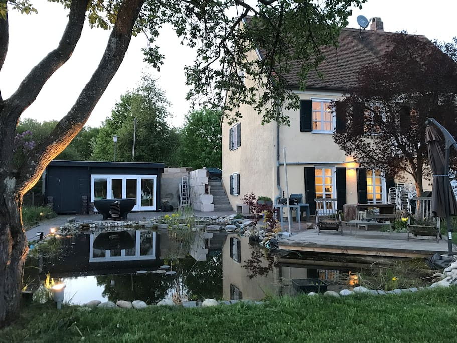 House with pond at dawn