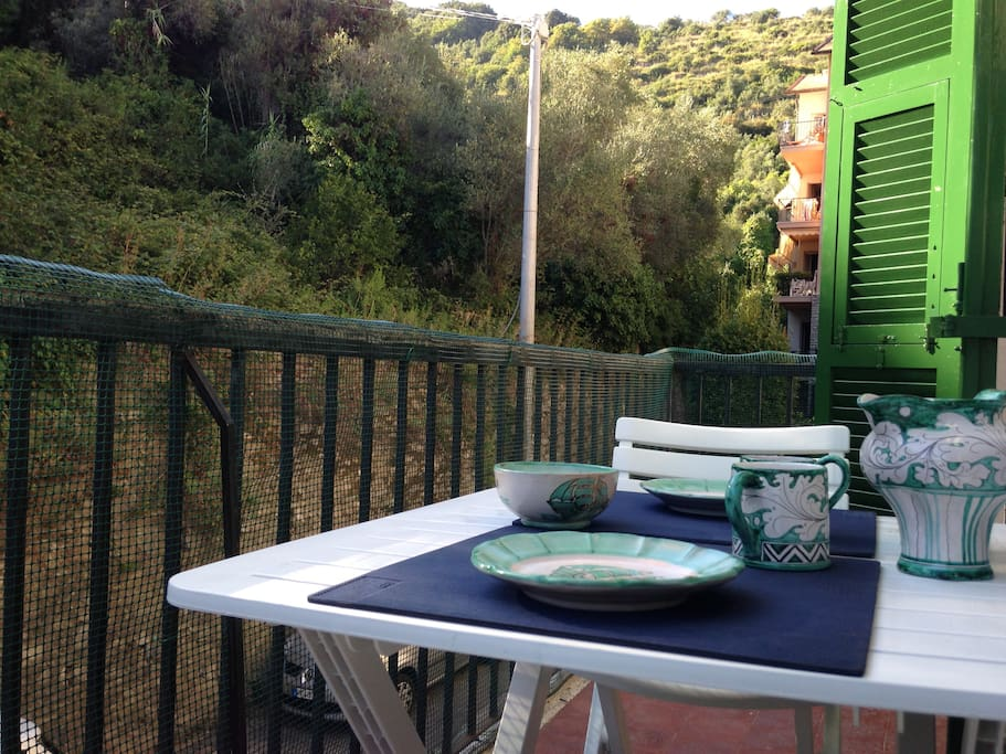 The apartment is in a quiet residential area surrounded by hills and olive trees