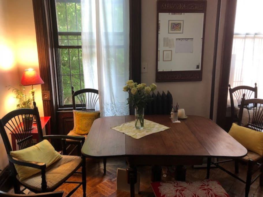 Elegant, 1885 brownstone 2nd floor with antique table to eat and sit at.