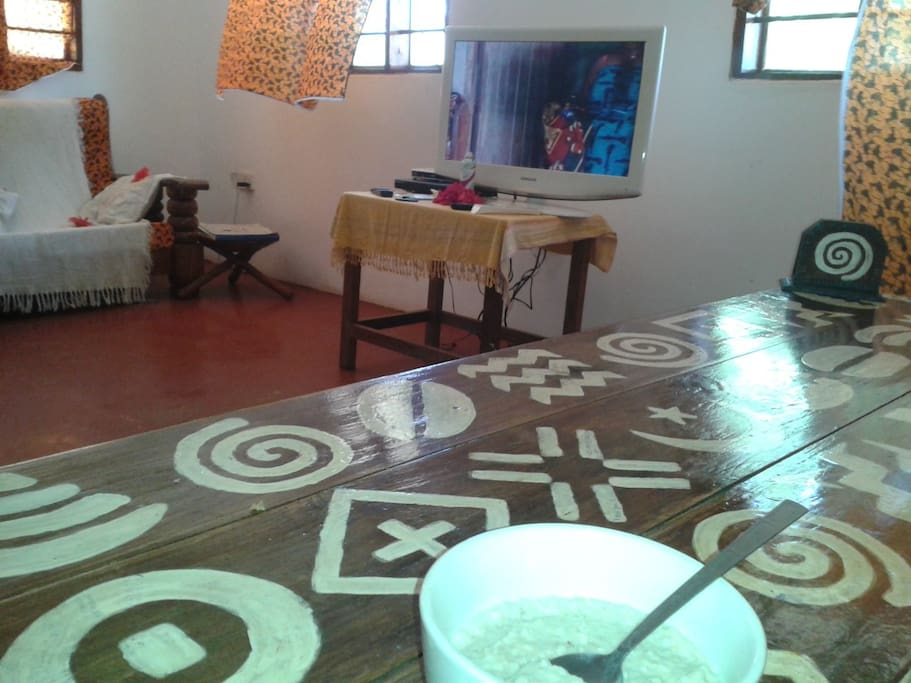 Common area with satellite TV and lots of DVDs to borrow.  30 more photos in listing for Magharibi House downstairs.