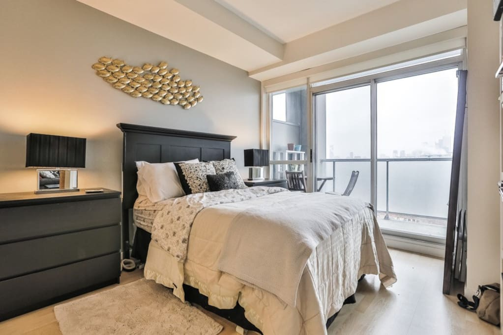 Cozy bedroom with access to balcony.
