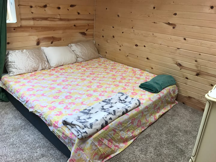 Entire woodcar sided basement-King Memory foam bed
