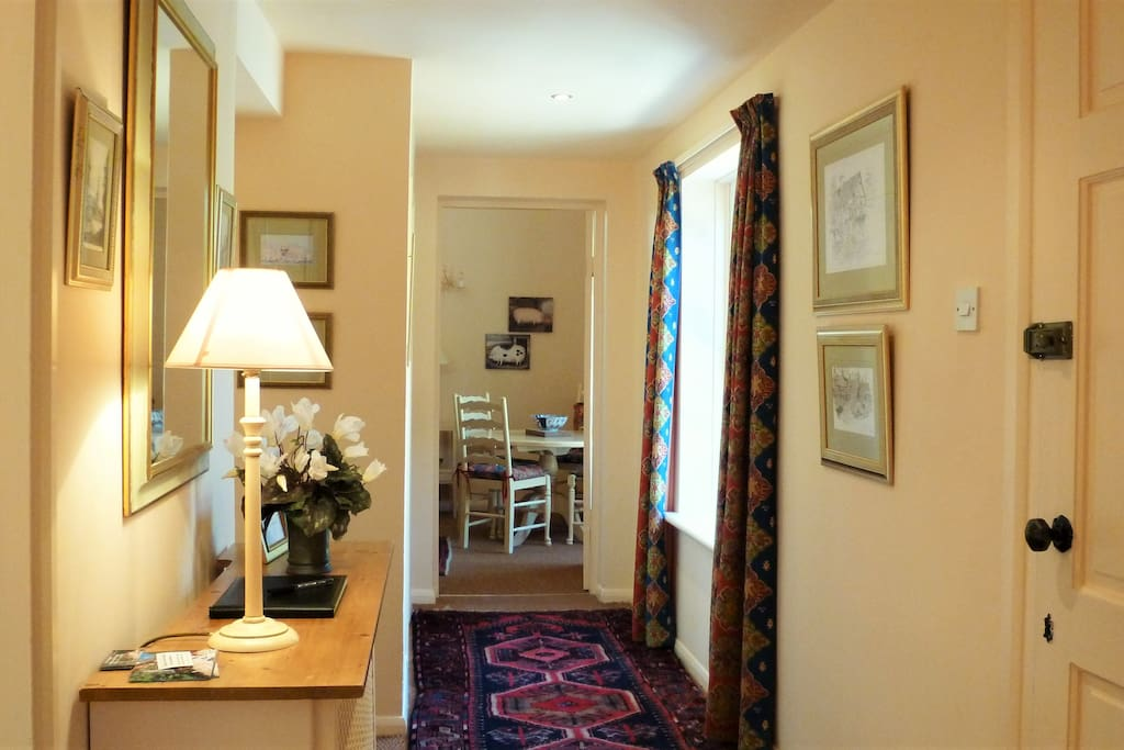 All of the rooms are accessed from the hall in this single storey cottage