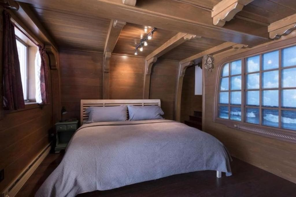 King-sized bed in simulated ship's cabin bedroom