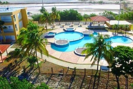 Playa del Caribe ( poblado combate y playa sucia)