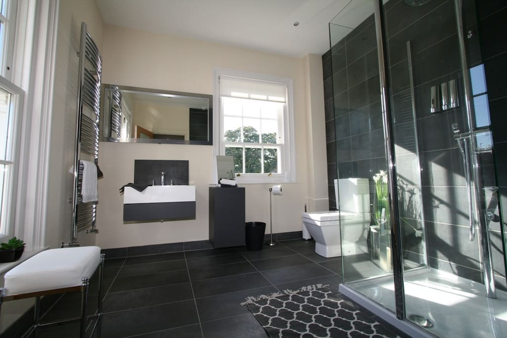 The ensuite with walk in raindrop shower and heated towel rail