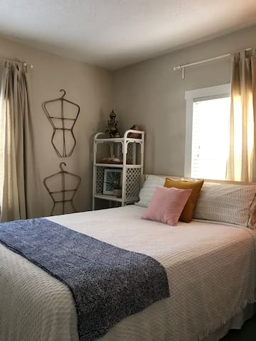 Second bedroom with a queen bed and sweet vintage touches
