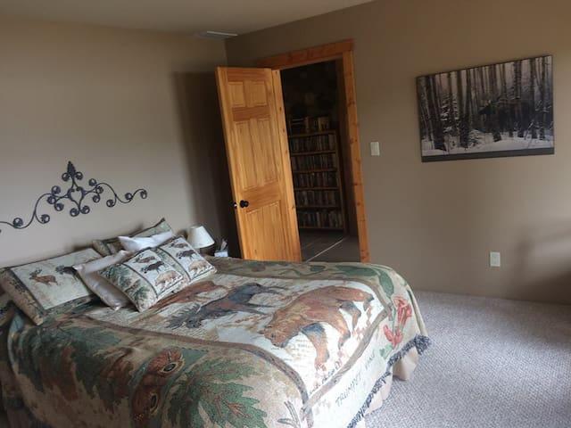 Room with Queen bed is done in Moose motif