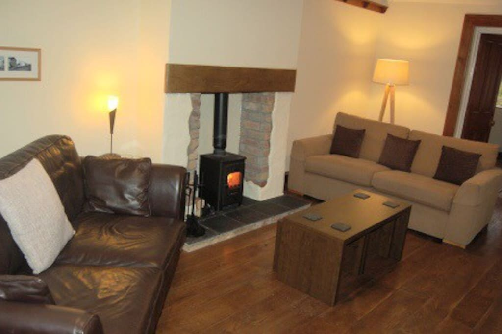 Large but cosy lounge with wood burning stove