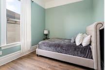 Bedroom 2: Super soft bedding adorn this comfy queen Tempurpedic style mattress