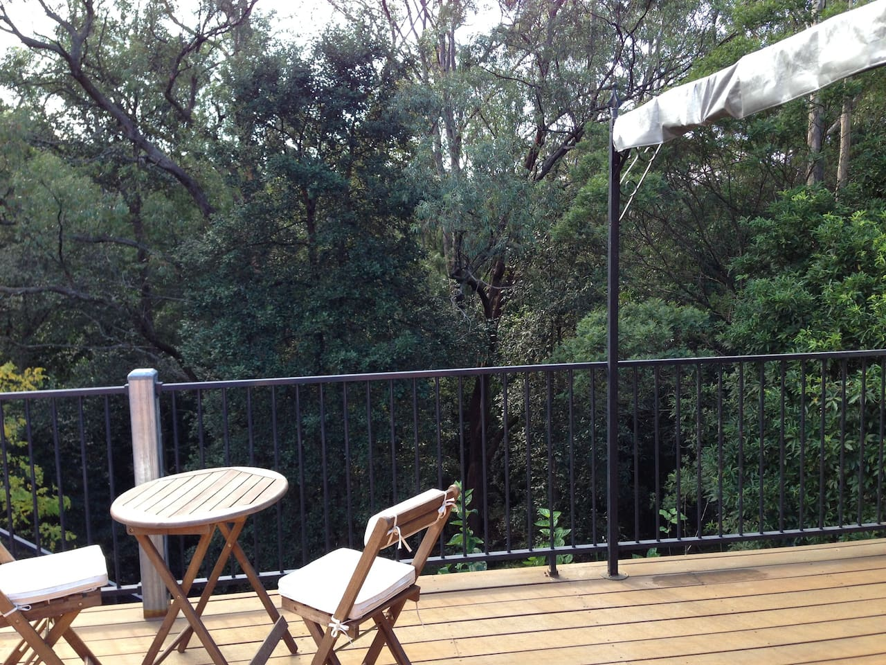 Large deck overlooking protected bushland.
