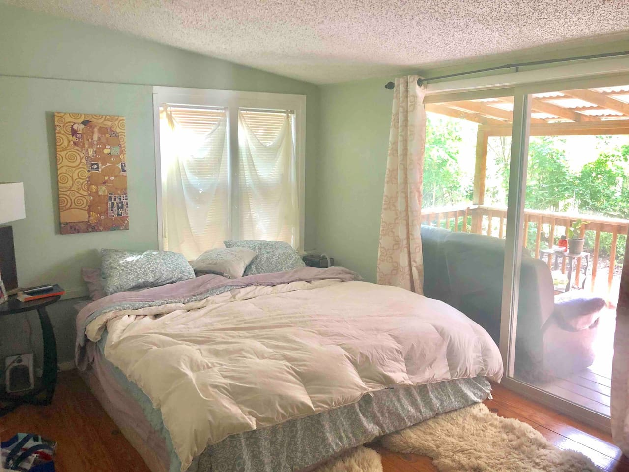 Master Bedroom with adjoining access to back porch and fire pit in backyard