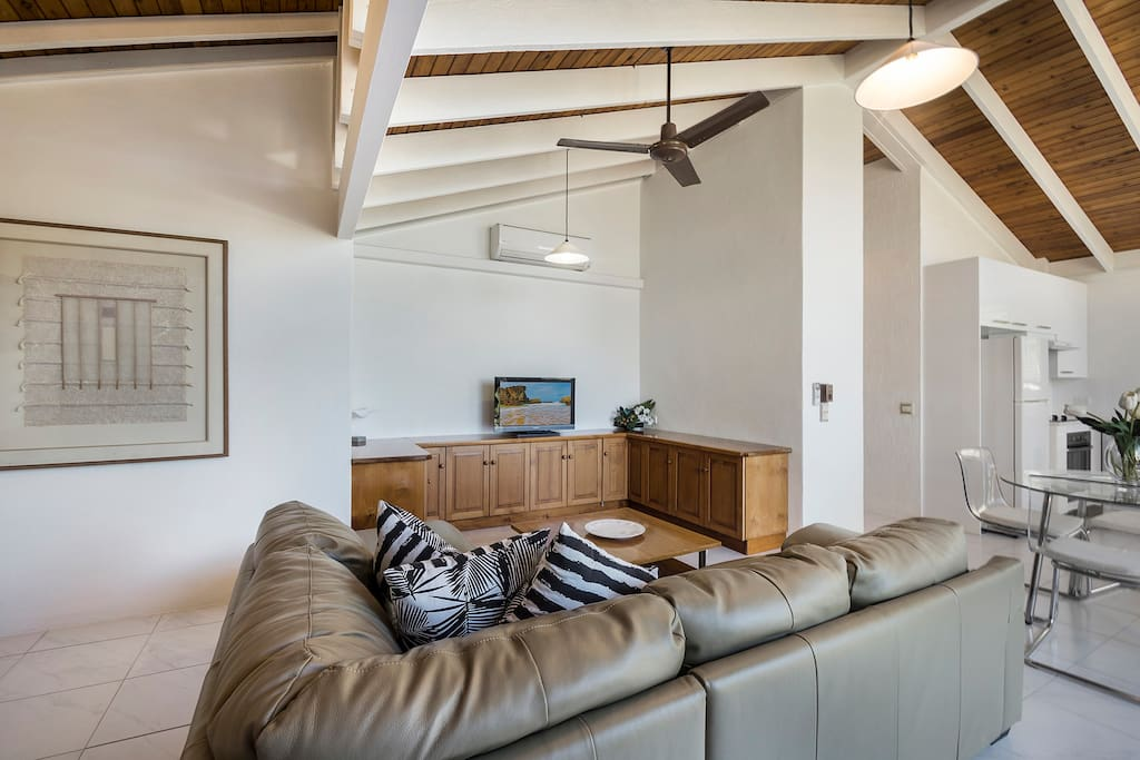 bright open lounge with fan and air conditioning