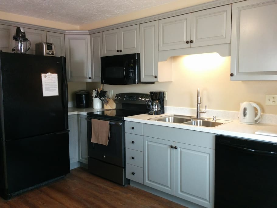 Spacious kitchen, fully outfitted for preparing meals after a long day of winter play.