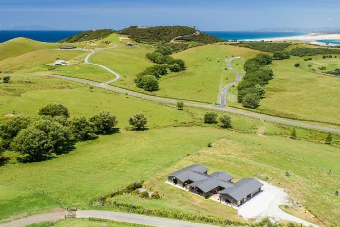 View over Breamtail Farm from behind the house looking to Mangawhai Beach and beyond