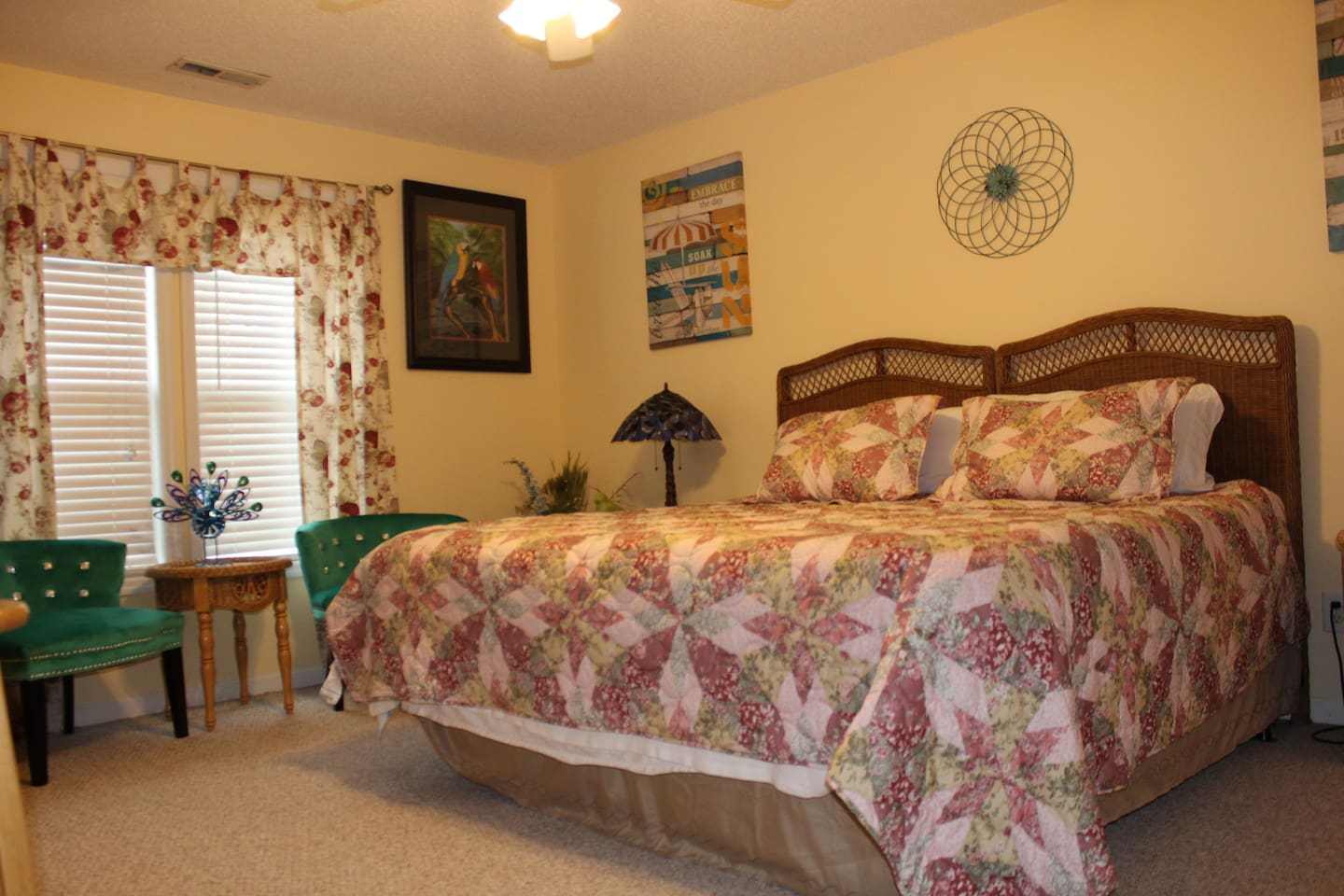 King Bed with chairs, full bath, kitchenette and bar. The king is two twins put together