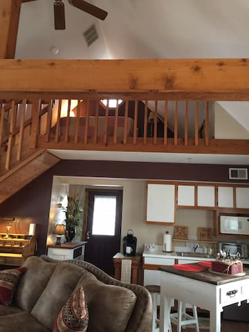 View of loft area from lower level