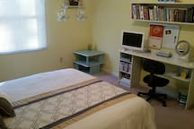 Bedroom with flatscreen with DVD player.