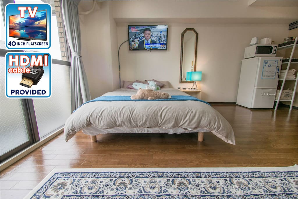 A lovely bright space with room to breathe and view to the wall-mounted TV from the sofa.