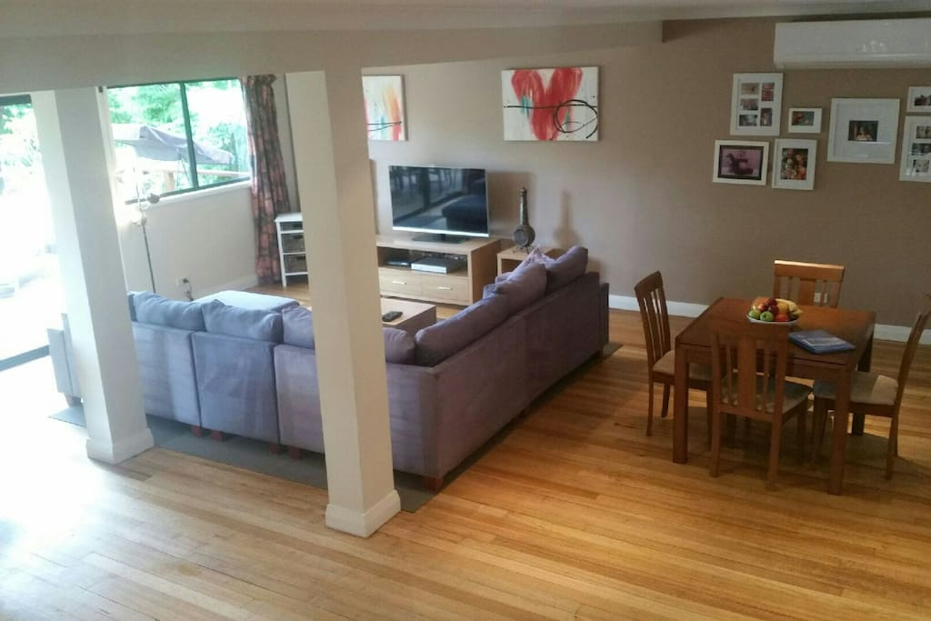 We have a large 7 seater couch, and plenty of toys/games/dvds for kids.  The dining table opens up to a 6 seater.. there is a kitchen bench to dine at, as well as a large table and chairs on the deck.