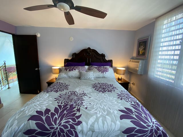 Queen size bed in a suite with private balcony