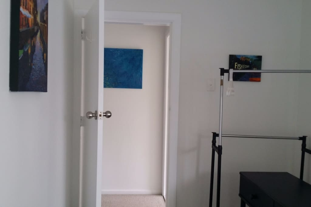 The bathroom is to the right through the door.