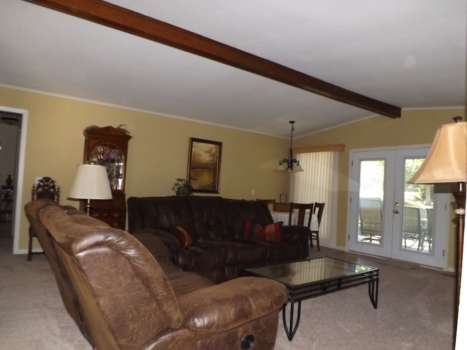 Step right into the den area from the kitchen. Enjoy the large tv and inviting sofas for lounging.