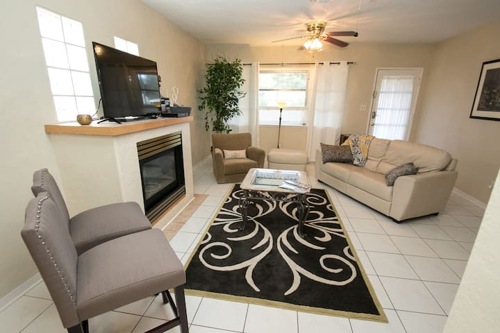 spacious living room with entry to front porch.