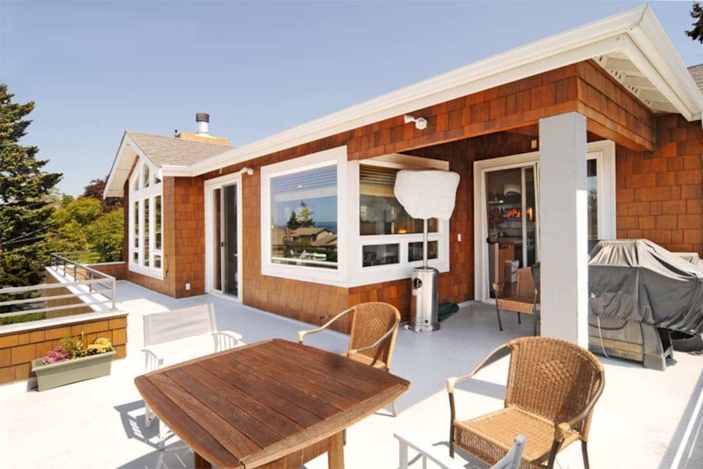 Relax on the deck with amazing views of Puget Sound and the Olympic Mountains