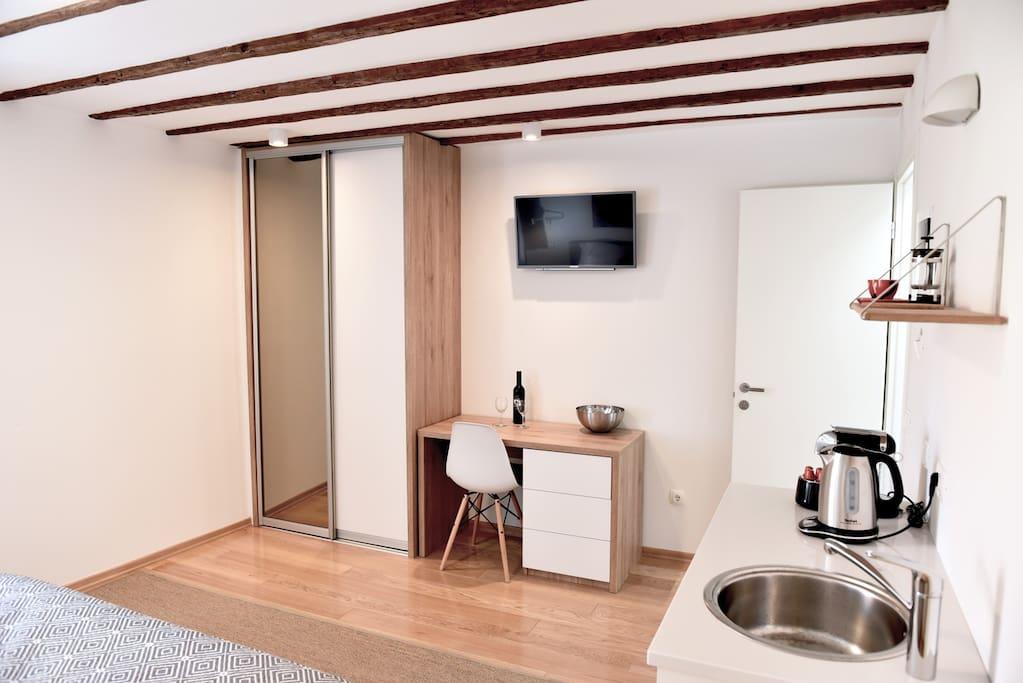 Desk, wardrobe and TV