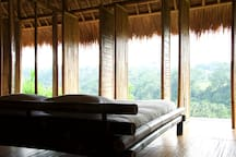 Bedroom with opened panels to let view and air in. Mosquito net is provided!