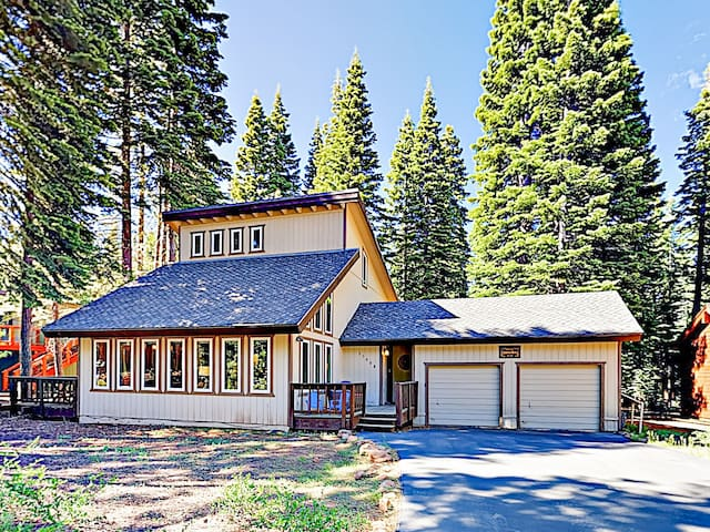 Located on a quiet wooded street, this modern 4BR home is the perfect mountain getaway.