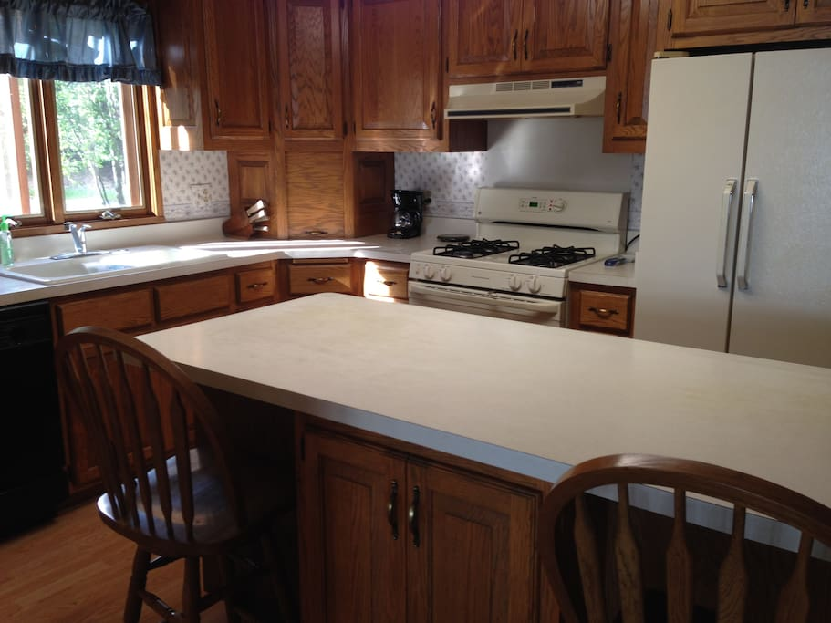 Custom built cabinets for ease in food preparation for 2-10.
