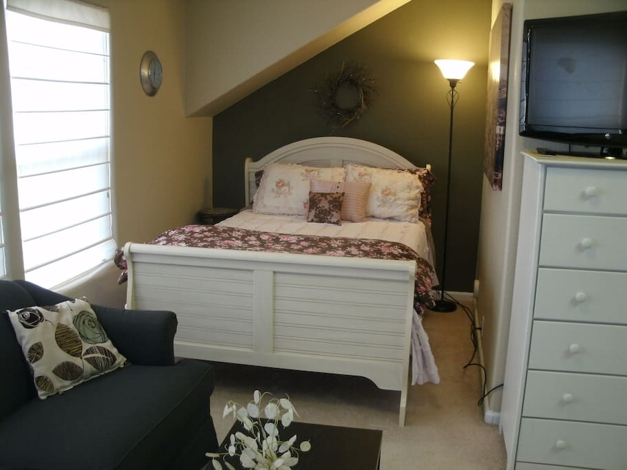 Bed/sleeping area with flat screen TV, wireless internet, cable & DVD player.