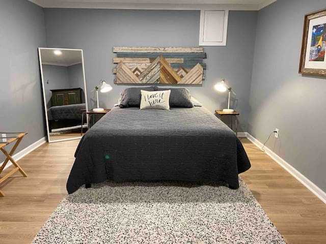 Master bedroom, Queen bed, closet and armoire.