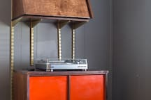 Vintage-mod record cabinet and custom bar and wall unit.