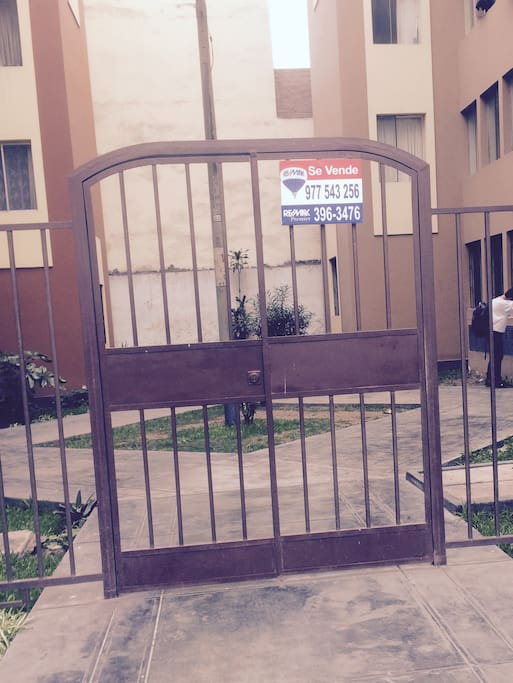 security is maintained with a gate to the building complex and a locked entryway for the actual building.