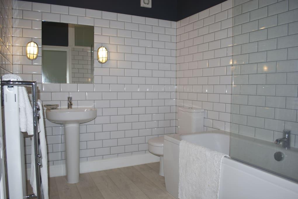 Bathroom has a heated towel rail, double ended bath with a powerful shower.