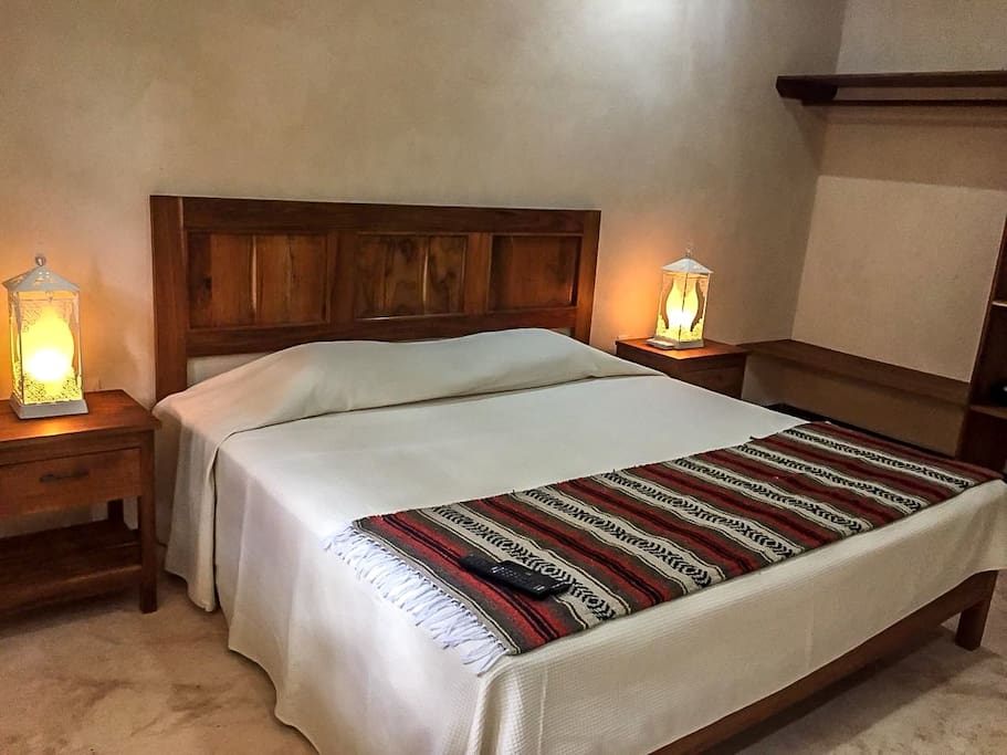 King Size bed / pillows / and night lamps