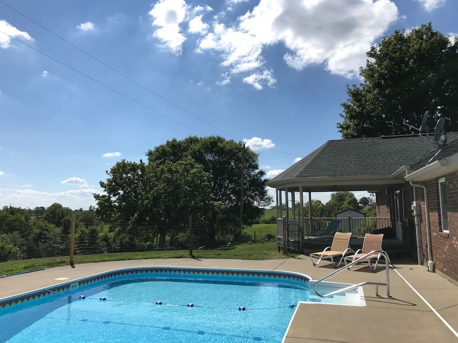 View of the fenced pool area! Pool towels provided during pool season!  Swim at your own risk. No lifeguard on duty. Buddy system enforced. All children must be supervised by adults. No intoxicated swimming. Safety rules strictly enforced and failure to abide will result in pool privileges being revoked.