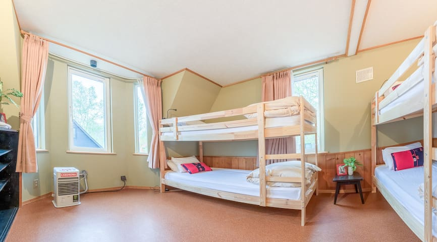 Spacious 4 person mixed dorm rooms with comfortable western bedding