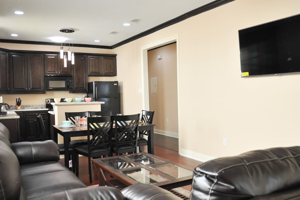 Relax in luxurious comfort and watch some big screen TV!
