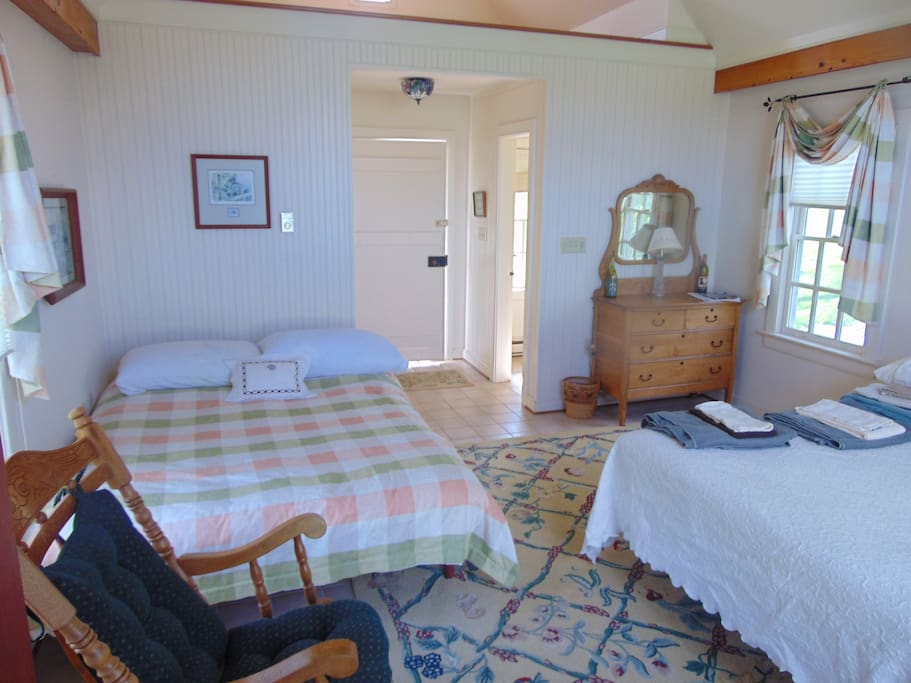 The main room features two double beds.
