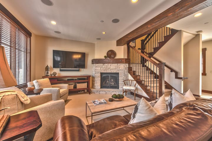 """Living Room with Comfortable Seating including a Sofa Sleeper, 65"""" Smart TV and Sonos Surround Sound, and Gas Fireplace"""